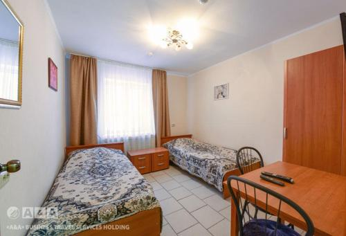 A bed or beds in a room at Viktoria Hotel