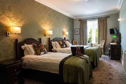 A bed or beds in a room at Fernhill House Hotel & Gardens