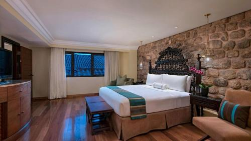 A bed or beds in a room at JW Marriott El Convento Cusco