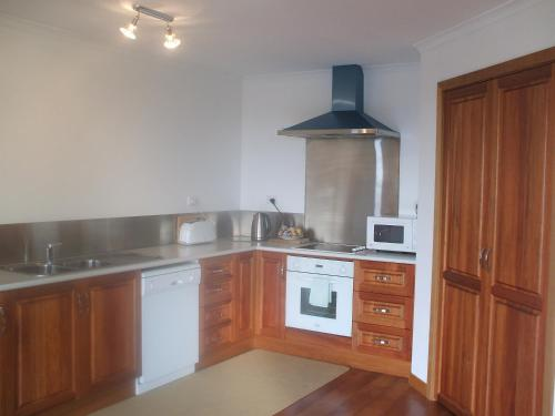 A kitchen or kitchenette at St Helens On The Bay