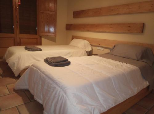A bed or beds in a room at Montserrat holidays Casa Rural