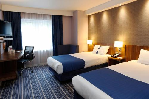 A bed or beds in a room at Holiday Inn Express Windsor