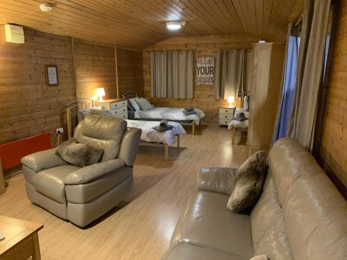 A seating area at Southernwood - Family Lodge