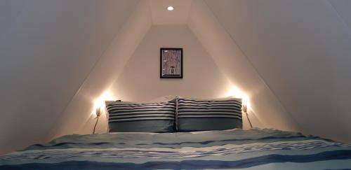 Een bed of bedden in een kamer bij Appartement Klein Waldeck