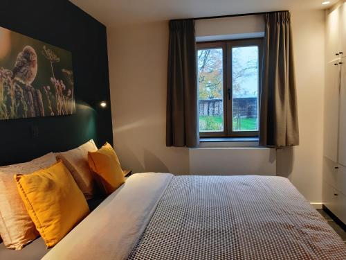 Een bed of bedden in een kamer bij De Bonderbei