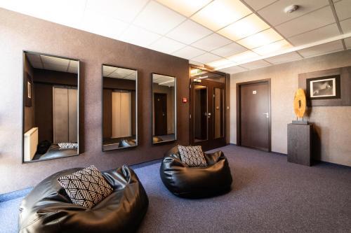 Coin salon dans l'établissement Interhotel Tatra