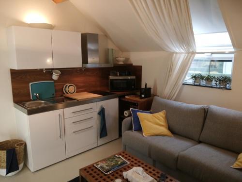 A kitchen or kitchenette at BC bed en comfort