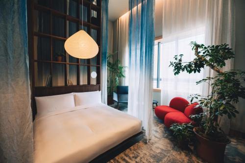 Un ou plusieurs lits dans un hébergement de l'établissement Hotel K5