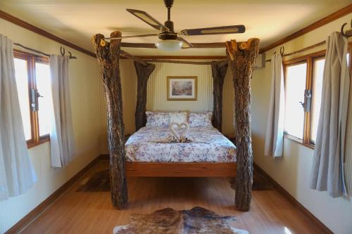 A bed or beds in a room at Ooraminna Homestead