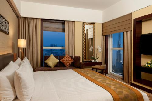 A bed or beds in a room at Dusit Thani Dubai