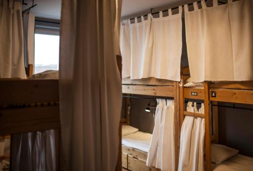 A bunk bed or bunk beds in a room at Hostel Flamingo Centrum