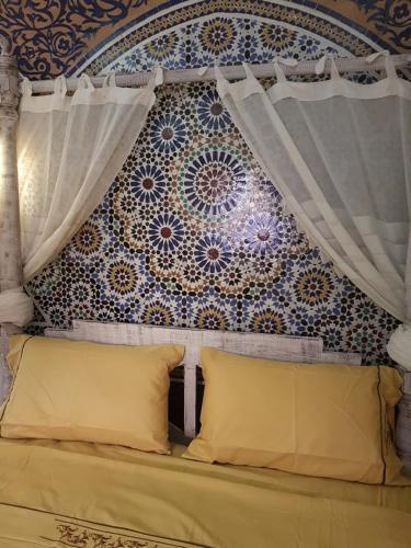 Un ou plusieurs lits dans un hébergement de l'établissement Riad Eloise