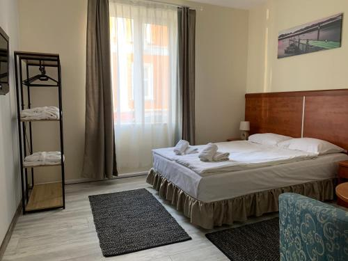 A bed or beds in a room at Guest Rooms Donovi