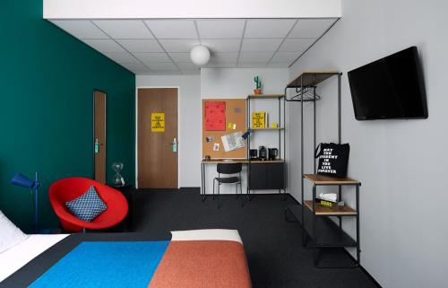A television and/or entertainment centre at The Student Hotel Rotterdam