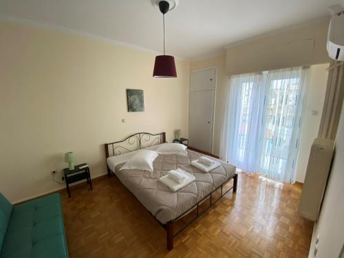 Postel nebo postele na pokoji v ubytování Animi Remissio seductive 3 bedroom apartment close to metro and Acropolis