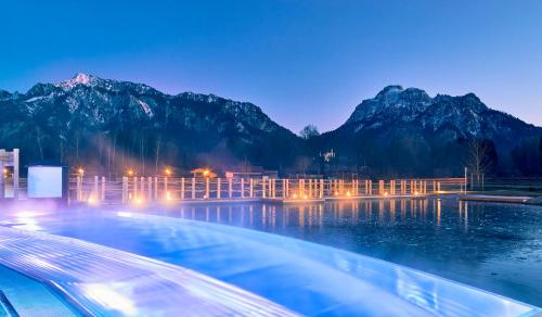 The swimming pool at or near Das König Ludwig Wellness & SPA Resort Allgäu