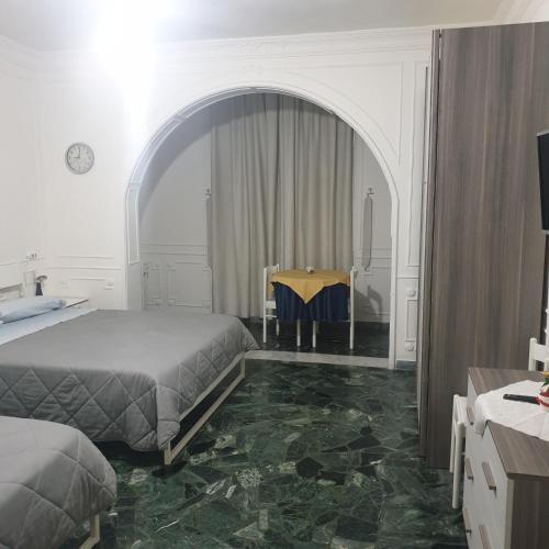 A bed or beds in a room at B&B Ganaj - Corso Italia 89 - BARI