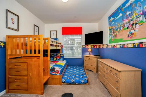 A bunk bed or bunk beds in a room at Disney Bunk Room--Windsor Hills