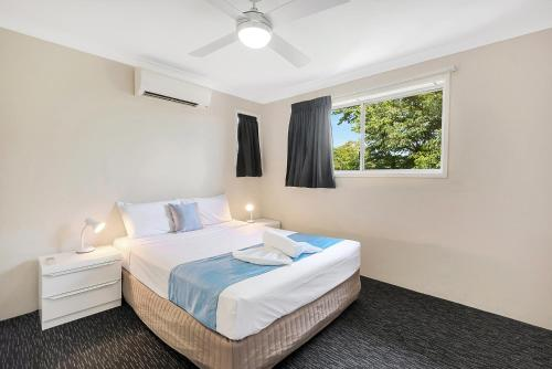 A bed or beds in a room at Leichhardt Motor Inn