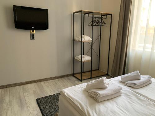 A television and/or entertainment center at Guest Rooms Donovi