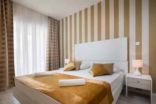 Łóżko lub łóżka w pokoju w obiekcie Perla Resort