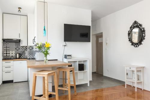 A television and/or entertainment center at Aldo apartment