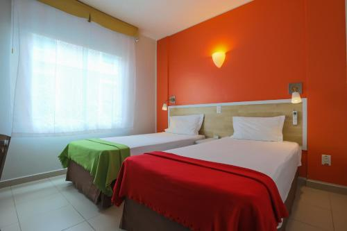 A bed or beds in a room at Go Inn Manaus