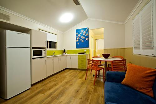 A kitchen or kitchenette at BIG4 Adventure Whitsunday Resort