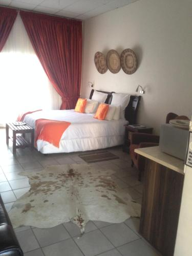 A bed or beds in a room at Welcome Guest House