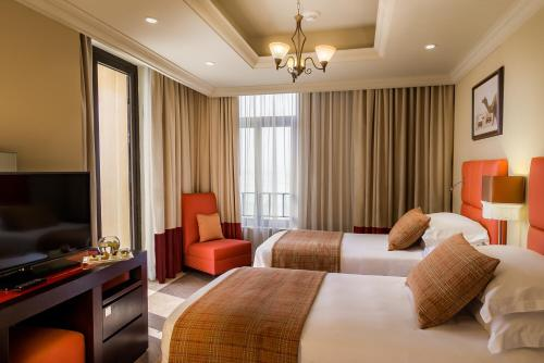 A bed or beds in a room at Arjaan by Rotana - Dubai Media City