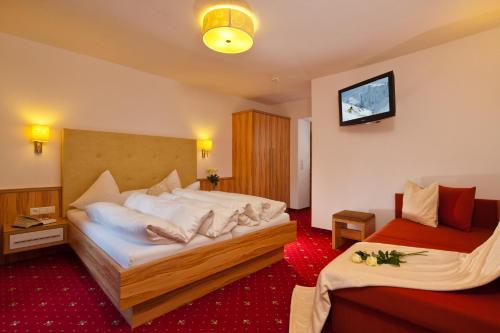 Ein Bett oder Betten in einem Zimmer der Unterkunft Apart Gletscherblick