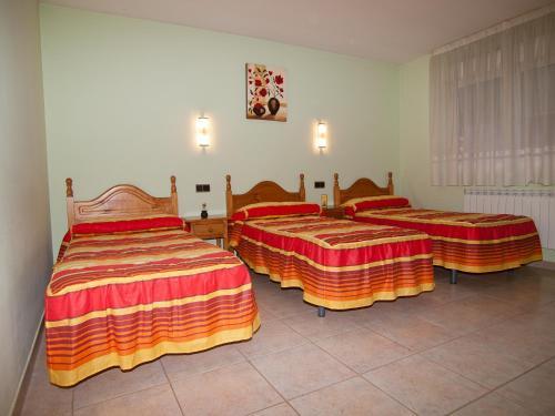 Cama o camas de una habitación en Hostal La Maravillosa