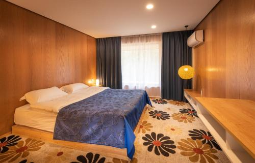 A bed or beds in a room at Asa Land