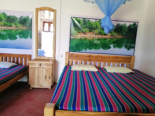 A bed or beds in a room at Jaya Home Stay