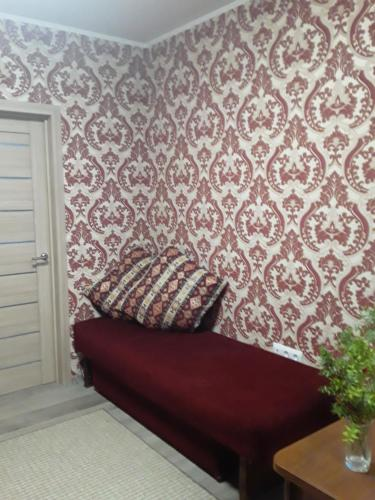A bed or beds in a room at гнездышко 13
