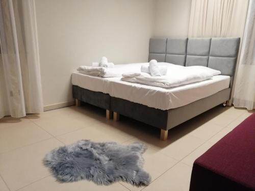 Łóżko lub łóżka w pokoju w obiekcie Dwór Spalice SPA Residence & Restaurant Lawendowa Restauracja
