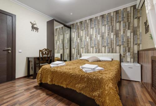Кровать или кровати в номере Авторский отель Шале