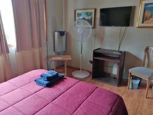Una cama o camas en una habitación de Como en Casa Like at Home