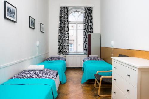 A bed or beds in a room at Hostel Diana Park
