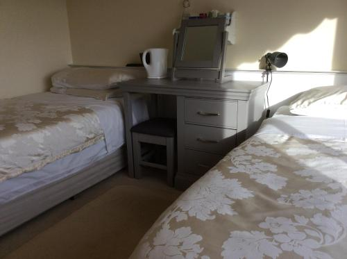 A bed or beds in a room at Hollymount House
