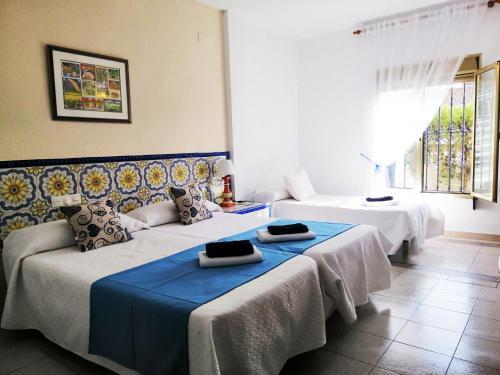 Cama o camas de una habitación en Hotel Matalascañas