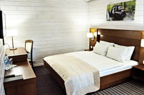A bed or beds in a room at Hotel 4x4