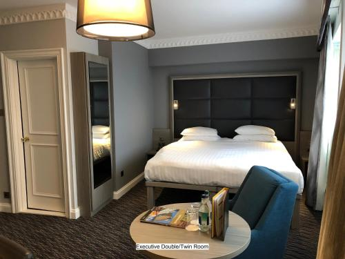 A bed or beds in a room at Birmingham Strathallan Hotel, BW Signature Collection