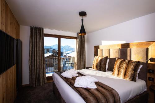 Letto o letti in una camera di Hôtel Daria-I Nor
