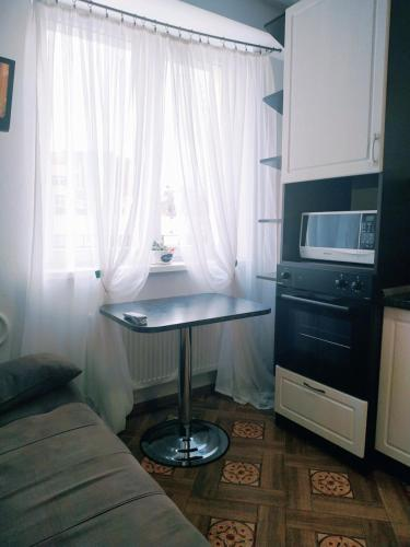 Кровать или кровати в номере Apartment u Korolevskikh vorot
