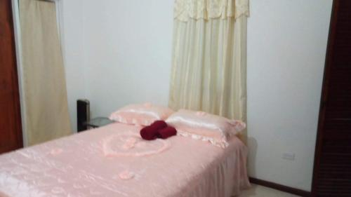 A bed or beds in a room at Cynson Villa Holiday Accommodations