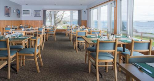A restaurant or other place to eat at Cabot Trail Motel
