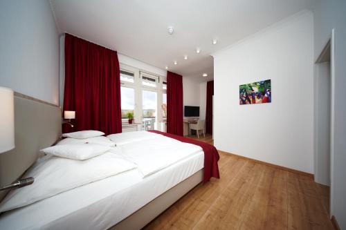 Ein Bett oder Betten in einem Zimmer der Unterkunft Parkhotel Pyrmont
