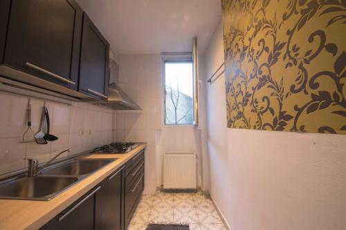 "A kitchen or kitchenette at ""Ateneu"" Apartments"