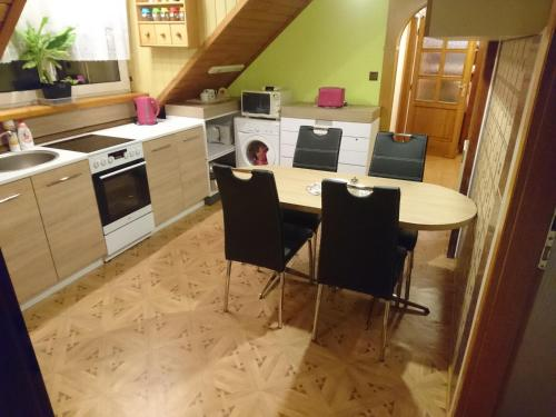 Kuchyň nebo kuchyňský kout v ubytování Apartment U Malše 12